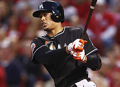 Giancarlo Stanton drives in three runs for Miami, which scored just one in losing its first two games. (Getty Images)