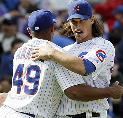 In just his sixth career start, Jeff Samardzija (right) works into the ninth before Carlos Marmol closes it out.    (AP)