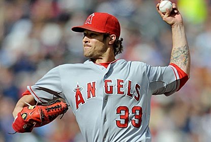 Almost lost in the Pujols hoopla, C.J. Wilson allows just three hits over seven strong innings in his Angels debut.  (Getty Images)