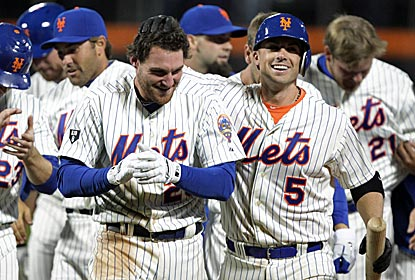 Daniel Murphy is all smiles after sending the Mets to their fourth win with the game-winning hit.  (US Presswire)