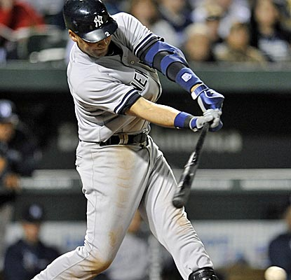 Derek Jeter grounds a single as part of a 4-for-4 night, helping the Yankees earn their first win.  (US Presswire)