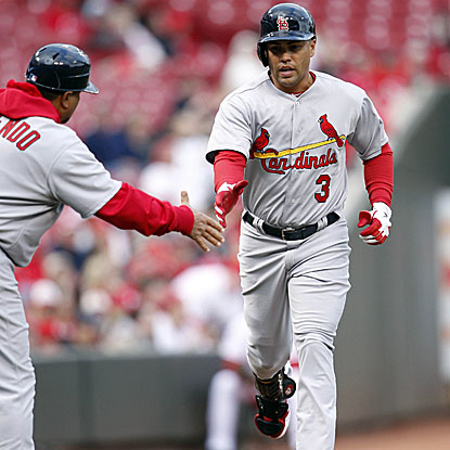 Carlos Beltran hits his third homerun of the season as the Cards improve to 5-1 with their win against the Reds.  (Getty Images)