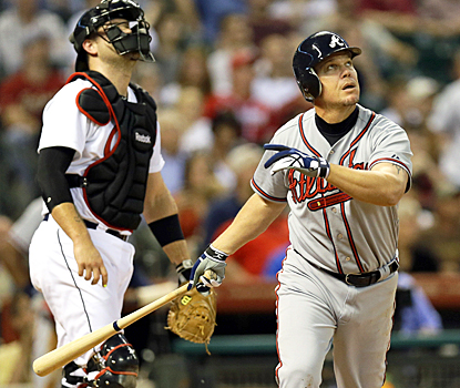 Atlanta's Chipper Jones watches as he hits a two-run home run in his first game of the 2012 season. (AP)