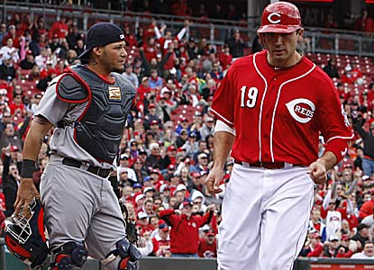 Joey Votto, who scores the go-ahead run here, ties his career best with four hits in the comeback win. (AP)