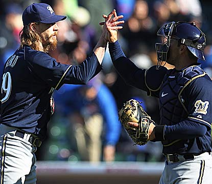 Catcher George Kottaras (right), who hits a two-run homer in the seventh, celebrates the win with closer John Axford. (Getty Images)
