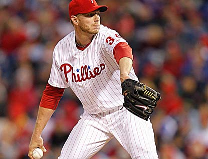 Roy Halladay gives up one run over seven innings for the Phillies, who had scored eight runs in their first four games. (Getty Images)