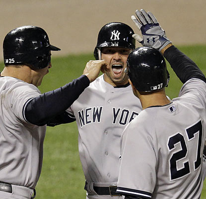Nick Swisher (middle) helps the Yankees complete a three-game sweep of the Orioles with a go-ahead two-run blast in the 10th. (AP)