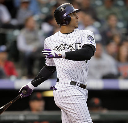 Carlos Gonzalez (3 for 5, 4 RBI) is one of eight Rockies to finish with two hits or more in the blowout against the Giants. (AP)
