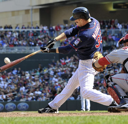 Justin Morneau finds his power swing at Target Field in the eighth inning against the Angels.   (AP)