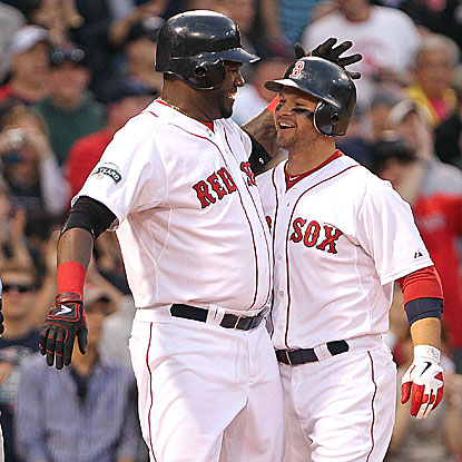 David Ortiz (left) collects four of the Red Sox's 15 hits, including his first home run of the season.  (Getty Images)
