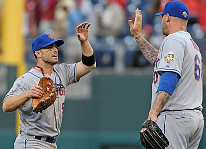 David Wright, who homers in his first at-bat in his return from a pinkie injury, celebrates the win with reliever Jon Rauch. (US Presswire)