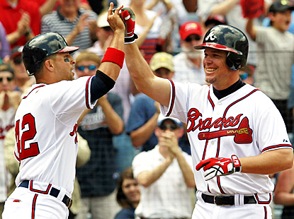 Chipper Jones celebrates after hitting a three-run home run in his first game back from a two-game layoff. (AP)