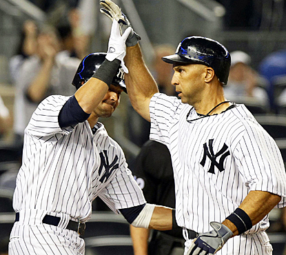 Nick Swisher (left) congratulates Raul Ibanez after hitting a two-run homer in the seventh inning. (US Presswire)
