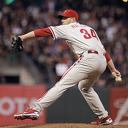The Phillies' Roy Halladay improves to 3-0 with eight solid innings against the Giants.  (AP)