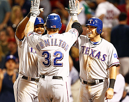 Elvis Andrus (left) and Ian Kinsler (right) celebrate with Josh Hamilton after he clobbers a home run in the eighth inning. (US Presswire)