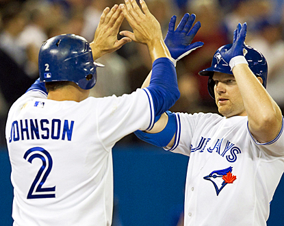 Adam Lind (right) congratulates teammate Kelly Johnson after scoring on Lind's two-run shot in the third inning. (AP)