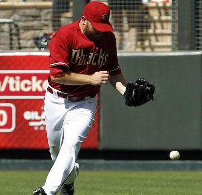 The Diamondbacks' Jason Kubel is unable to catch Neil Walker's bloop, which gives the Pirates the winning run.  (AP)