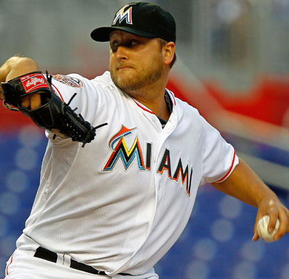 Mark Buehrle yields one run on six hits to earn his first Miami victory in his first start at Marlins Park.  (Getty Images)