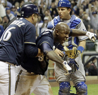 Nyjer Morgan is called safe at home plate, sending the Brewers home happy with a win over the Dodgers.  (AP)