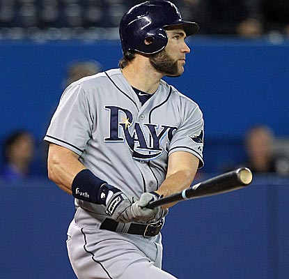 Luke Scott connects for a two-run double in the ninth inning as the DH's strong season continues.  (US Presswire)