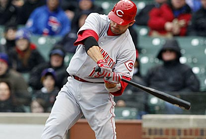 Joey Votto connects for an RBI single as the Reds defeat the Cubs for the franchise's 10,000th win. (US Presswire)