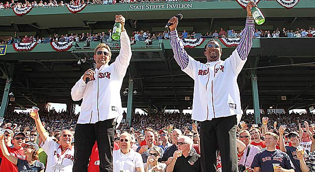 Former Red Sox players Kevin Millar and Pedro Martinez lead a toast. (Getty Images)