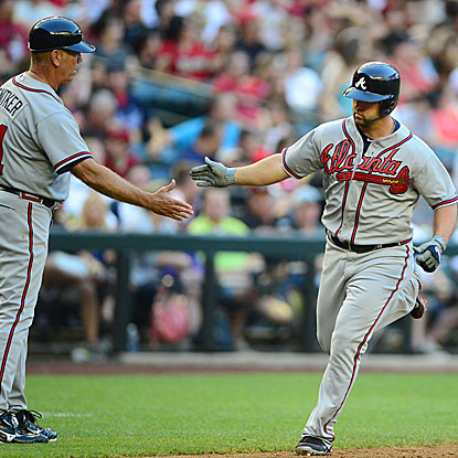 Dan Uggla's home run breaks a 2-all tie to lift the Braves over the Diamondbacks, their 10th win in 11 games. (US Presswire)