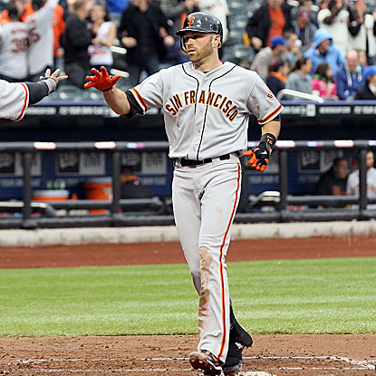 Nate Schierholtz knocks a homer and a triple to help lift the Giants over the Mets in game one of their doubleheader.  (Getty Images)