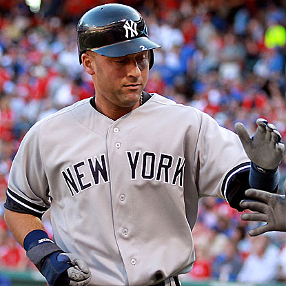 Derek Jeter extends his hitting streak to 13 games with a 4-for-5 performance in the Yankees' win over the Rangers.  (Getty Images)