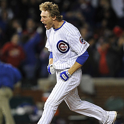 Former Cardinal Joe Mather's two-out, two-run single in the ninth inning rallies the Cubs to victory.  (AP)