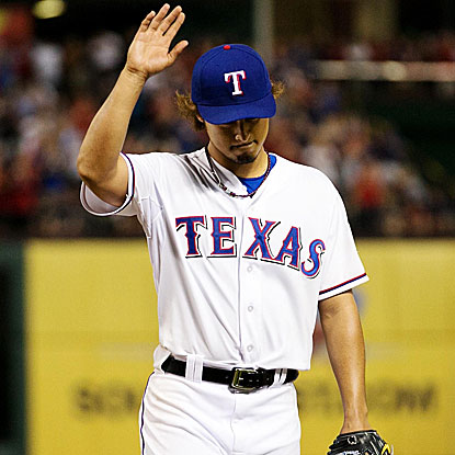 Yu Darvish is saluted by the Rangers fans for his performance against the Yankees, 8 1/3  innings of scoreless ball.  (US Presswire)