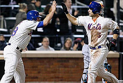 David Wright (right) hits a two-run homer to reach 735 RBI, passing Darryl Strawberry for the most in Mets history. (Getty Images)