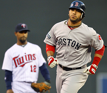 Mike Aviles rounds second base after hitting a three-run shot in the second inning against the Twins. (AP)
