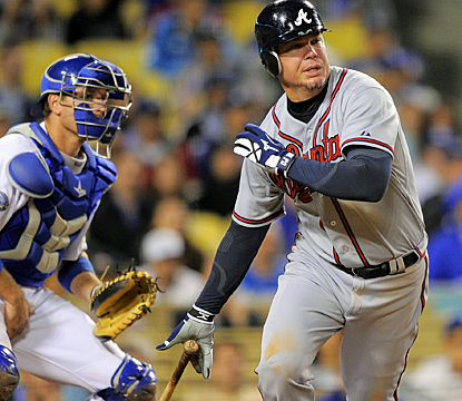 Chipper Jones follows through on his ninth-inning single that drives in the go-ahead run against the Dodgers. (AP)