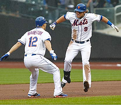 Kirk Nieuwenhuis drives in the winning run for the Mets, who walk four times against Marlins All-Star closer Heath Bell. (US Presswire)