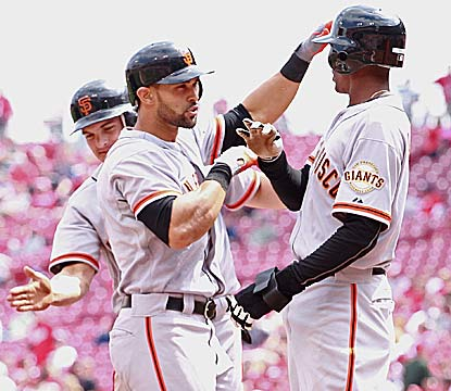 Angel Pagan (left) hits a three-run homer in the ninth for the Giants, who avoid a sweep and end a seven-game skid. (Getty Images)
