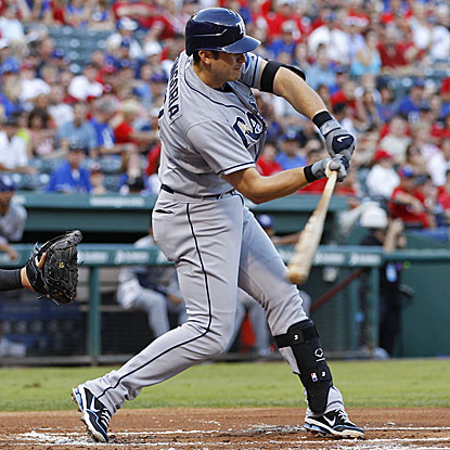 Evan Longoria homers to key a four-run first inning that leads the Rays past the Rangers.  (US Presswire)