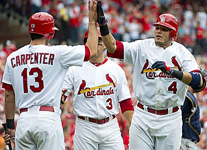 Yadier Molina gets praise after tying his career high with a 4-for-4 outing, which includes a two-run tiebreaking homer.  (US Presswire)