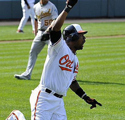 The Orioles' Wilson Betemit reacts after hitting a walk-off three-run homer to cap a five-run ninth inning.  (US Presswire)