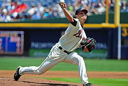 Tim Hudson, making his first start after offseason back surgery, gives up just two runs on six hits.  (Getty Images)