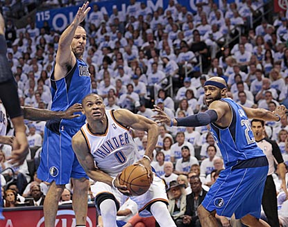 Russell Westbrook, who winds up with 29 points, finds a way around Jason Kidd (left) and Vince Carter in the first half.  (Getty Images)