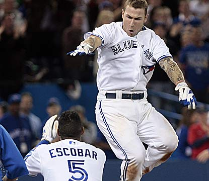 Canadian pride Brett Lawrie jumps for joy after hitting the walk-off homer in front of the home crowd. (Getty Images)