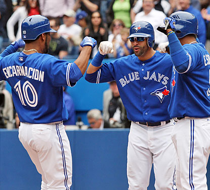 Edwin Encarnacion gets a hero's welcome at the plate after his three-run homer puts away the Rangers.  (US Presswire)