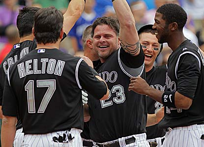 Jason Giambi's (No. 23) game-winning three-run homer overshadows Carlos Gonzalez's two-homer game. (Getty Images)
