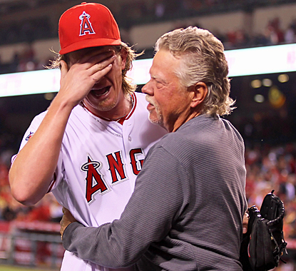 Jered Weaver shares some happy tears with his father Dave after pitching the first no-hitter of his major-league career.  (Getty Images)