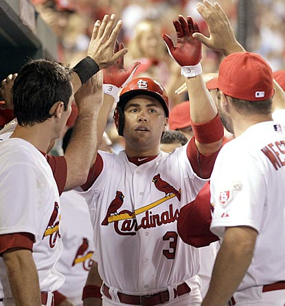 The Cardinals welcoming committee welcomes back Carlos Beltran after he belts his second three-run roundtripper.  (AP)