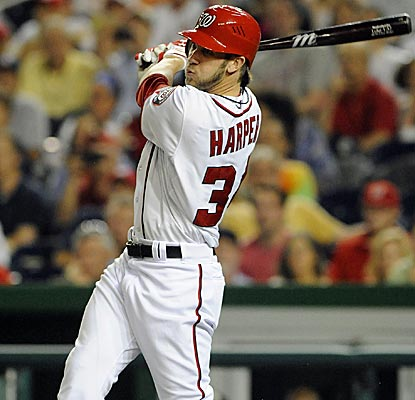 Bryce Harper drives an RBI double in the sixth inning, which will prove to be the game-winning hit. (US Presswire)