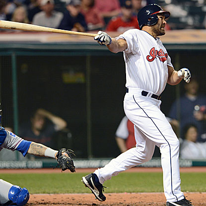 In his first game in Cleveland as a member of the Indians, Johnny Damon drives in two runs with a triple.  (Getty Images)