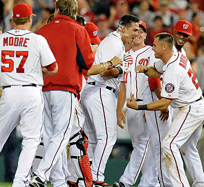 Wilson Ramos is cheered by teammates after delivering a single with two outs in the bottom of the 11th. (Getty Images)