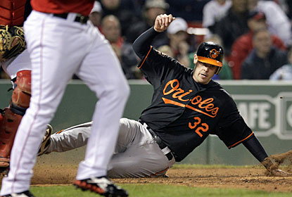 Baltimore's Matt Wieters slides at home plate to score a run in the 13th off a single by Chris Davis. (AP)